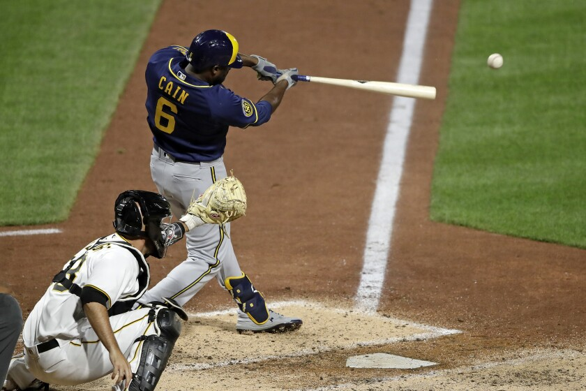 Milwaukee Brewers' Lorenzo Cain drives in a run with a single off Pittsburgh Pirates relief pitcher Nik Turley during the seventh inning of a baseball game in Pittsburgh, Monday, July 27, 2020. (AP Photo/Gene J. Puskar)