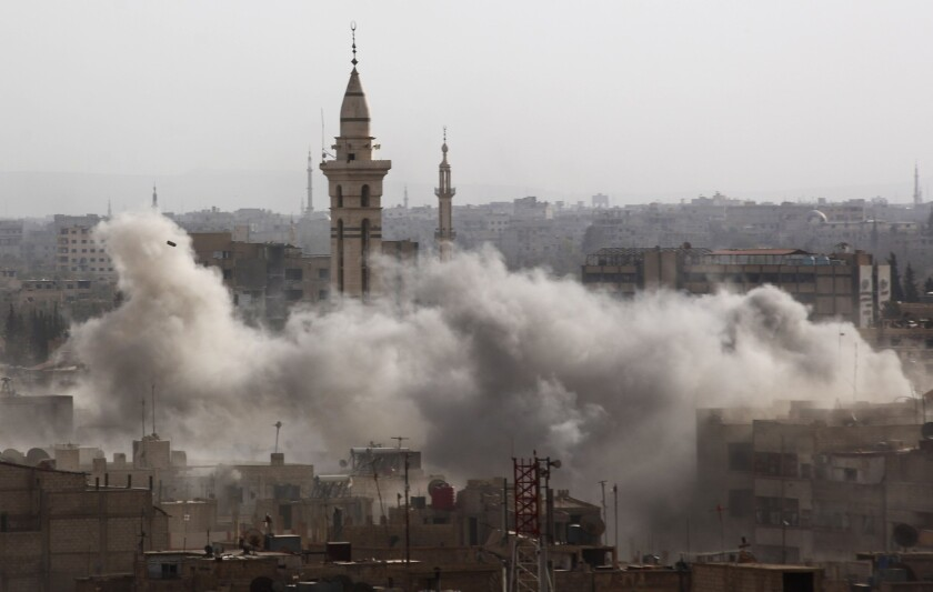 Smoke billows from the rebel-held area of Duma, northeast of the Syrian capital, Damascus, after a reported airstrike by government forces on Sept. 16.