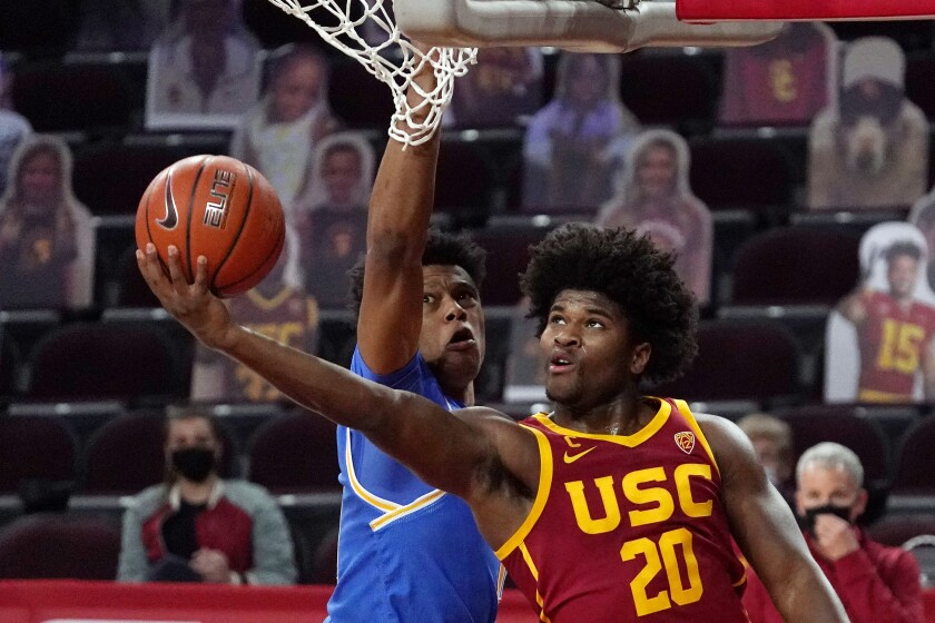 USC's Ethan Anderson shoots over UCLA's Jaylen Clark during the Trojans' win on Feb. 6.