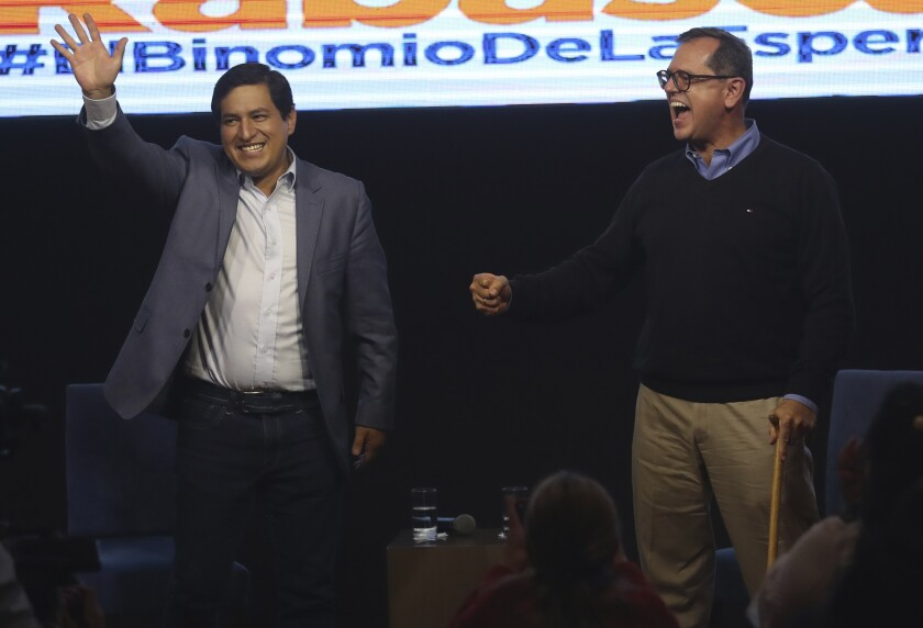 Esperanza-UNES- alliance party presidential candidate Andres Arauz, left, and his running mate Carlos Rabascall celebrate as they wait for the official results to know if they have reached the necessary percentage to win in the first electoral round, in Quito, Ecuador, Sunday, Feb. 7, 2021. (AP Photo/Dolores Ochoa)