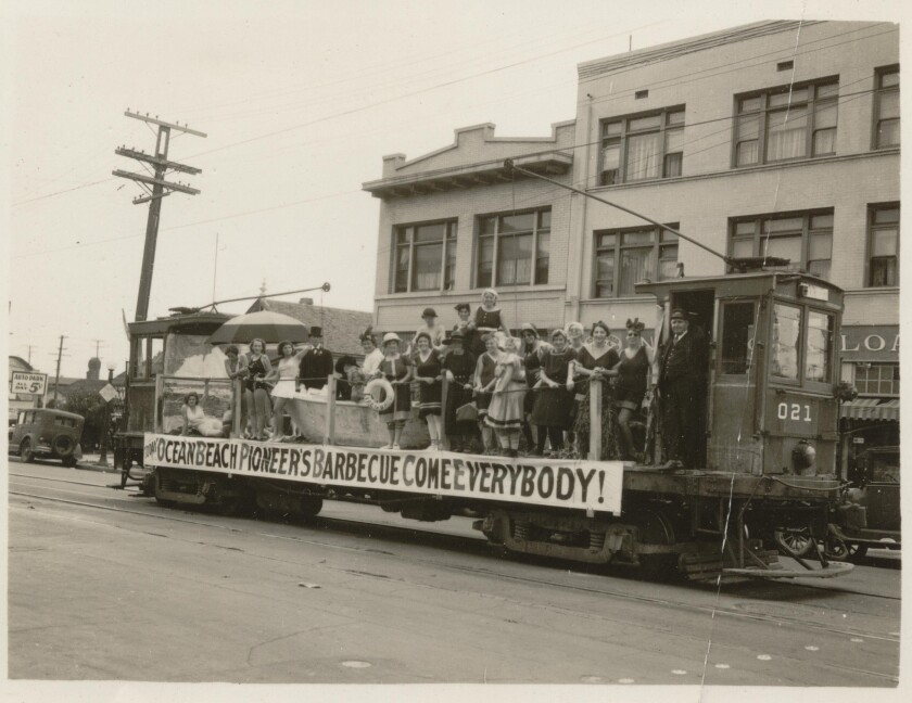 A San Diego Electric Railway flat car served as a float to advertise the 1934 Ocean Beach Pioneers Picnic and Barbecue.