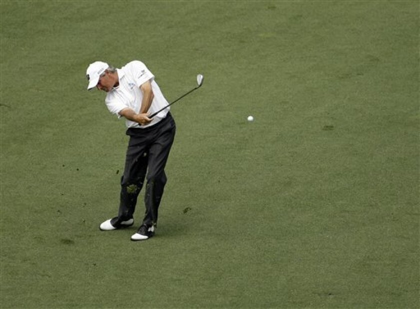 Fred Couples hits off the ninth fairway during the second round of the Masters golf tournament Friday, April 8, 2011, in Augusta, Ga. (AP Photo/Charlie Riedel)