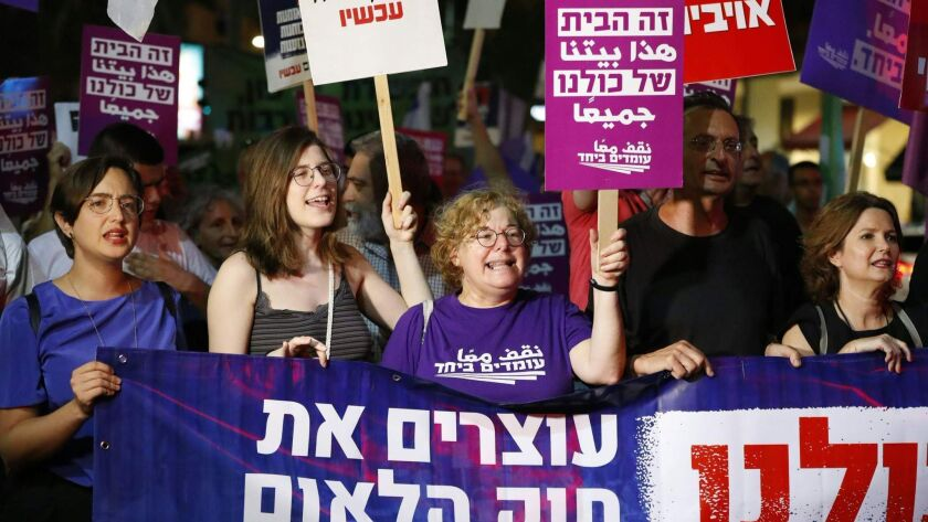 """Demonstrators attend a rally to protest against the """"Jewish Nation State Bill"""" in the Israeli coastal city of Tel Aviv on July 14, 2018."""