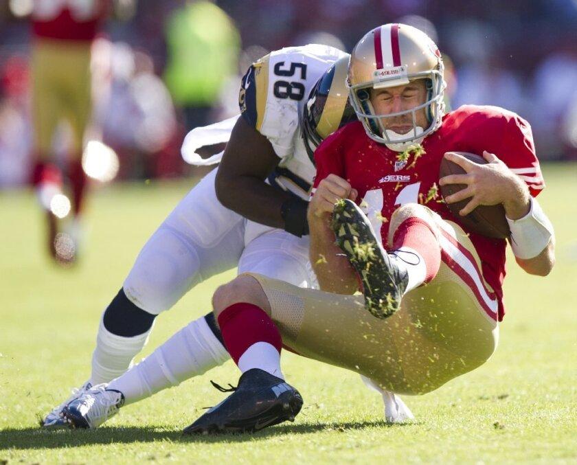 St. Louis Rams linebacker Jo-Lonn Dunbar blasts head-first into San Francisco 49ers quarterback Alex Smith last November, a play in which Dunbar was injured.