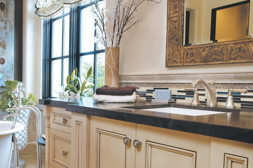 Stylish vanity faucets, like this California Faucets' Catalina widespread in Satin Nickel, can give your master bath an easy and tasteful update.