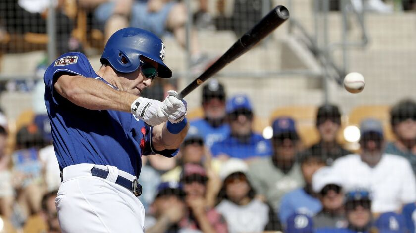 Los Angeles Dodgers' Chase Utley hits during the first inning of a spring training baseball game aga