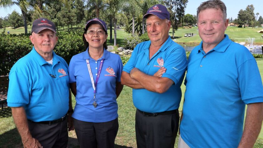 Poway Veterans Organization co-founders Ed Berger, left, Moon Rash, second from left, and Bill McKibbin, right, with charity golf tournament director Nick Yorio, second from right, at the Country Club of Rancho Bernardo on Monday. Not pictured: co-founder Dennis Rasumussen.