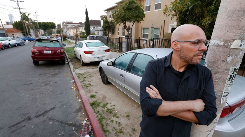 Stephen Sedalis at the corner of Witmer Street and Miramar Street in the Westlake neighborhood, where a growing number of residents park their cars on parkways.