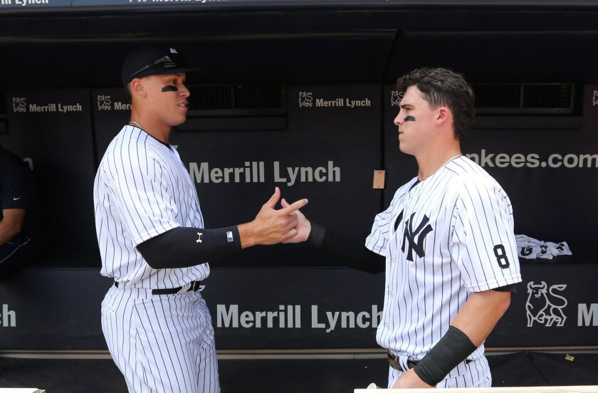 New York Yankees' Aaron Judge, left, and Tyler Austin greet each other in the dugout before their baseball game against the Tampa Bay Rays Saturday, Aug.13, 2016, at Yankee Stadium in New York. (John Munson/The Star-Ledger via AP, Pool)