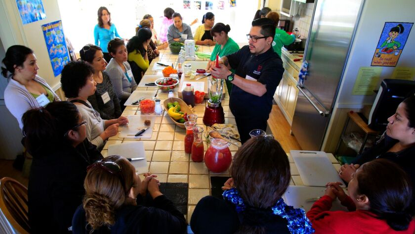 """Chef Miguel Valdez teaches a 2016 """"Cooking for Salud"""" class at Olivewood Gardens and Learning Center in National City."""