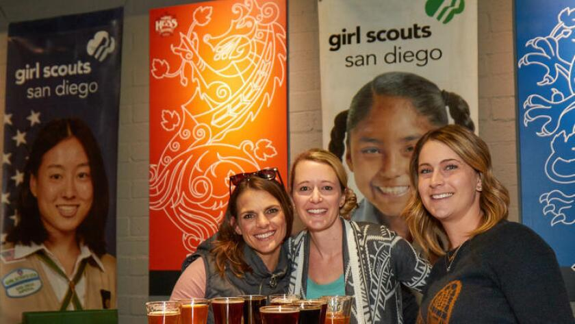"""From left, Emmi Fowler, Kelly Simpson and Alyssa Schott during last year's """"Cookies on Tap"""" fundraiser at Mike Hess Brewing. (Tim Stahl / Courtesy of Girl Scouts San Diego)"""