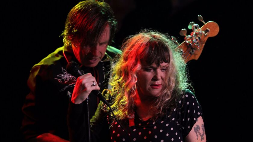 X's John Doe and Exene Cervenka, shown during a 2014 performance in West Hollywood, will be saluted along with longtime bandmates Billy Zoom and DJ Bonebrake during the Dodgers' Aug. 16 game with the Chicago White Sox.