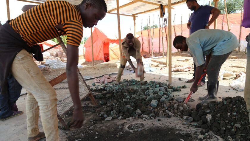 Artisanal miners sort cobalt and other minerals on the road between Kolwezi and Lubumbashi in the Democratic Republic of Congo.