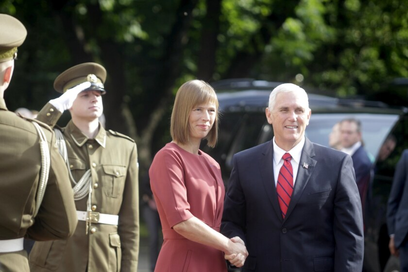 Estonian President Kersti Kaljulaid shakes hands with Vice President Mike Pence during their meeting in Tallinn, Estonia, on July 31, 2017.