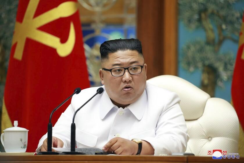 Kim Jong Un attends a meeting.