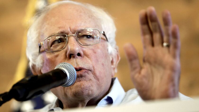 Sen. Bernie Sanders, shown Aug. 17, wants big companies to foot the bill for government benefits their low-wage workers receive.