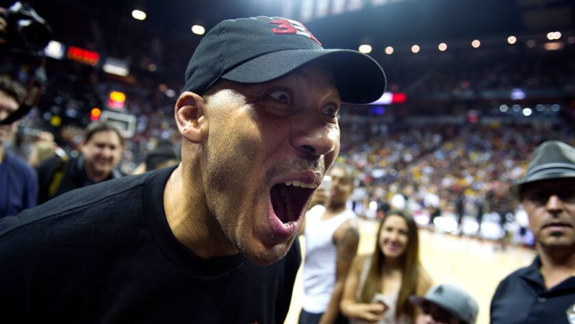 LAS VEGAS, NEVADA JULY 7, 2017-LaVar Ball greets fans during halftime at the NBA Summer League at th