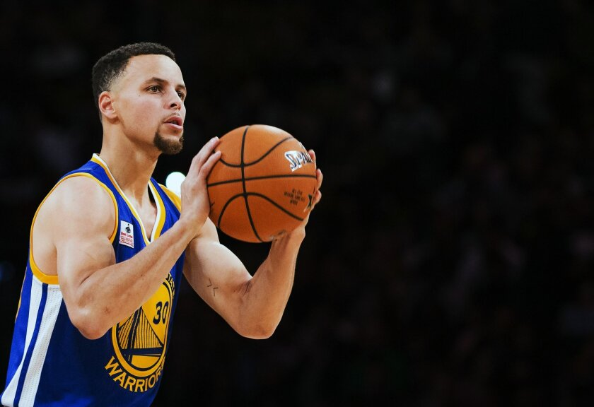 Golden State Warriors guard Stephen Curry (30) competes in the three point NBA all-star skills competition in Toronto on Saturday, Feb. 13, 2016. (Mark Blinch/The Canadian Press via AP) MANDATORY CREDIT