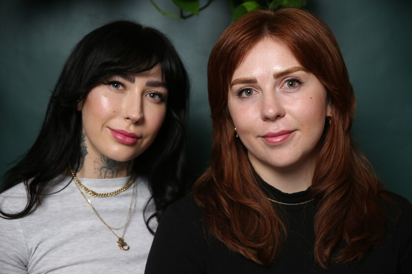 Kahli Smith, co-owner of Fiction Cosmetic Tattooing, left, with Tess Henderson after a microblading procedure.
