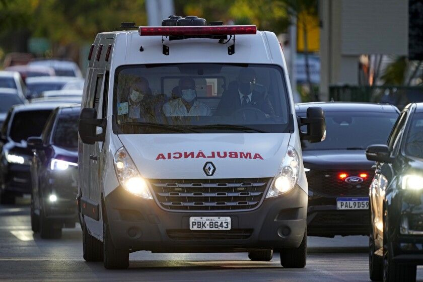 An ambulance takes Brazil's President Jair Bolsonaro from the Armed Forces Hospital where he had been admitted, to an airbase to be airlifted to Sao Pualo, in Brasilia, Brazil, Wednesday, July 14, 2021. After suffering from 10 days of hiccups, Bolsonaro was admitted to the Brasilia hospital but later officials said he would be transferred to another hospital in Sao Paulo for tests to determine if surgery is needed. (AP Photo/Eraldo Peres)