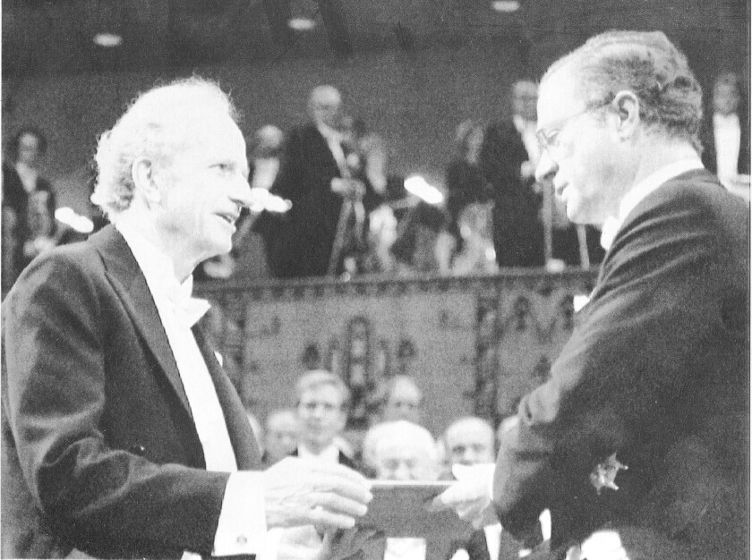 Gary S. Becker, left, receives the 1992 Nobel Prize in economic sciences. Becker is credited with pioneering the approach to economics as a study of human behavior