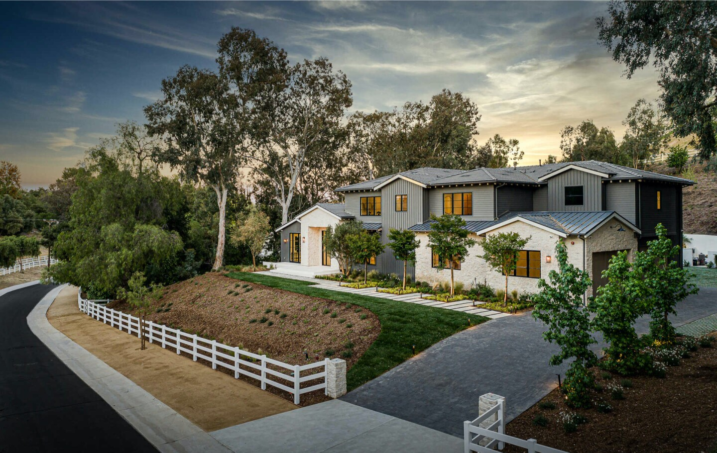 Built in 2020, the amenity-loaded home spans nearly 10,000 square feet with six bedrooms, 7.5 bathrooms, a movie theater, wine cellar and gym.