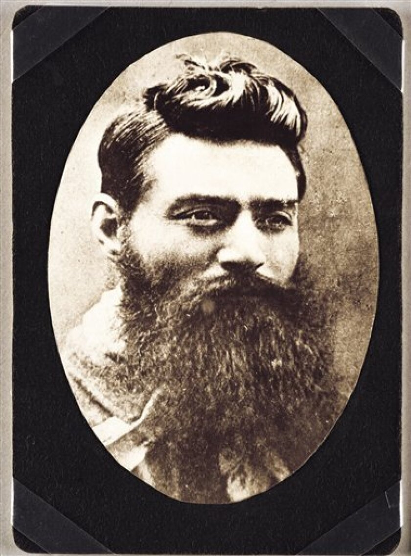 In this undated photo released by the State Library of Victoria, a framed photograph shows Ned Kelly, Australia's most infamous criminal, the day before he was hanged at a prison called the Old Melbourne Gaol - now a historic site - in Melbourne, Australia. The headless remains of Kelly have been identified, officials said Thursday, Sept. 1, 2011, ending a decades-long mystery surrounding the final resting place of a man now seen by many as a folk hero. (AP Photo/State Library of Victoria) EDITORIAL USE ONLY, NO SALES