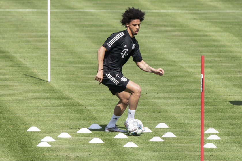 Leroy Sane, new player of the German first division, Bundesliga, soccer team FC Bayern Munich, takes part in a training session in Munich, Germany, Tuesday, July 14, 2020. (Matthias Balk/dpa via AP)