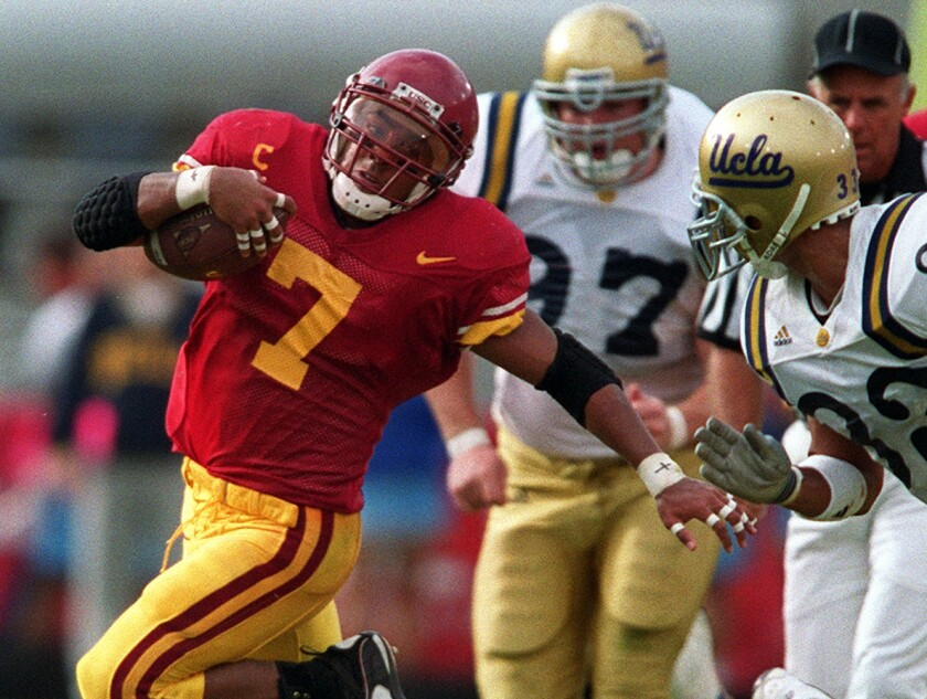 USC tailback Chad Morton eludes the grasp of a UCLA defender during the Trojans' 17-7 victory at the Coliseum on Nov. 20, 1999.