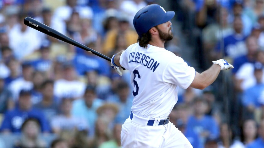 Dodgers seond baseman Charlie Culberson watches his walk-off home run against the Rockies on Sept. 25, 2016, at Dodger Stadium.