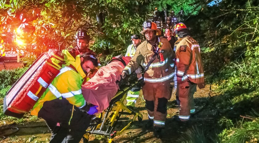 Atlanta firefighters transport a man in a gurney.