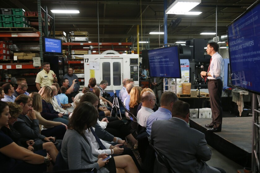Republican presidential candidate Scott Walker presents his plan to replace Obamacare during a visit to Cass Screw Machine Products in Brooklyn Center, Minn. on Aug. 18.