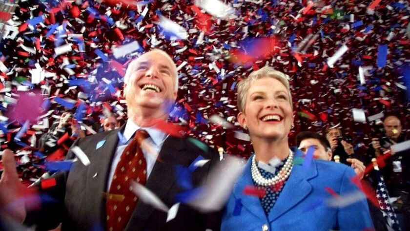 Confetti falls on Republican presidential hopeful Sen. John McCain (R-Ariz.) and his wife, Cindy, at the end of their 114th New Hampshire town hall meeting with voters in Peterborough, N.H., in January 2000.