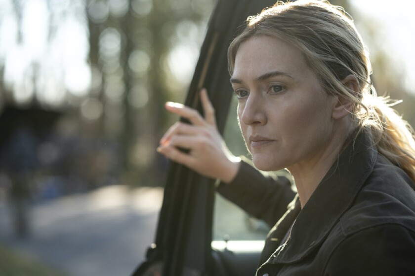 """Kate Winslet stares ahead in a scene from """"Mare of Easttown."""""""