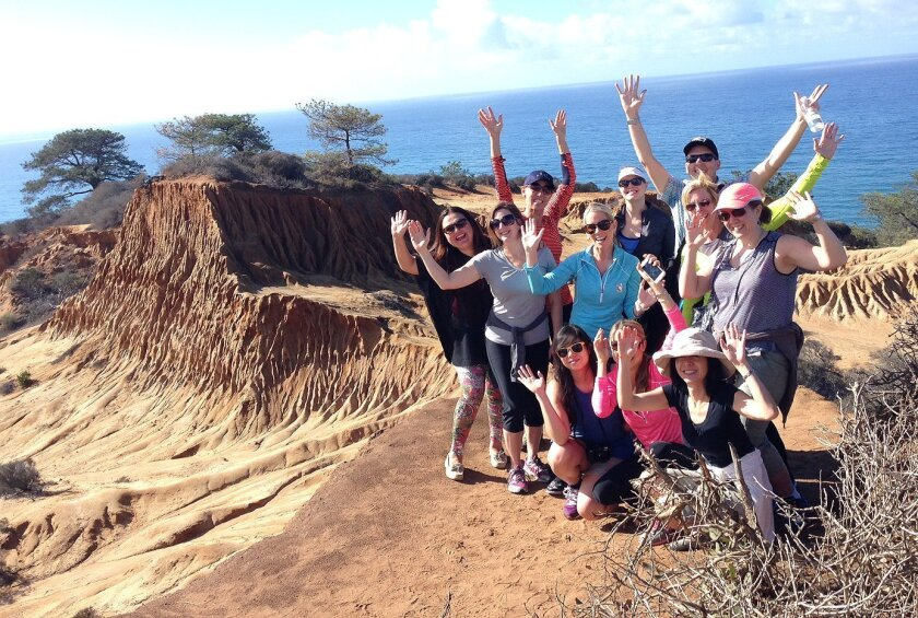 San Diego Tourism Authority public relations manager Robert Arends leads a media tour of key La Jolla businesses and destinations in November 2014 including the Torrey Pines State Reserve.