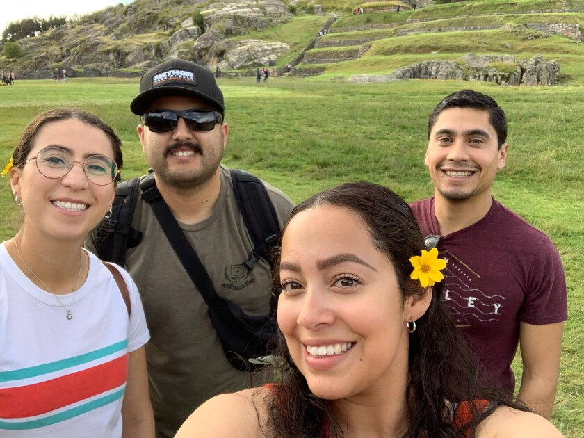 Evelin Pineda, her brother and friends pose for a selfie in Peru.