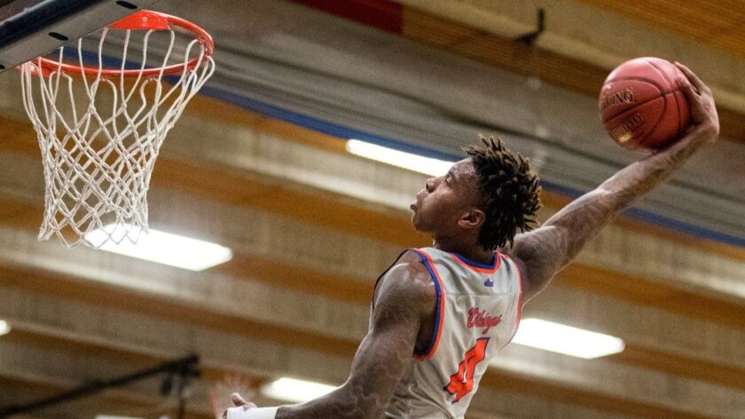 Kevin Porter (4) of Rainier Beach dunks the ball after stealing it from O'Dea during the second half