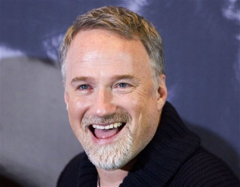 """In this photo taken Jan. 5, 2012, U.S. director David Fincher smiles during a photo call for the movie """"The Girl with the Dragon Tattoo""""in Berlin, Germany. The Walt Disney Studios will film a new version of """"20,000 Leagues Under the Sea"""" in Australia after the country agreed to pay it 21.6 million"""
