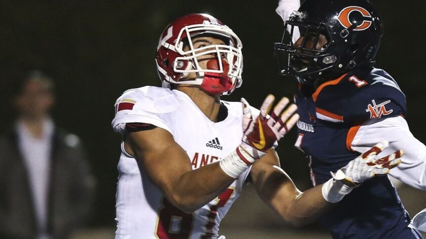 LOS ANGELES, CA - NOVEMBER 10, 2017: Orange Lutheran's Kyle Ford (81) left, tries to catch the ball
