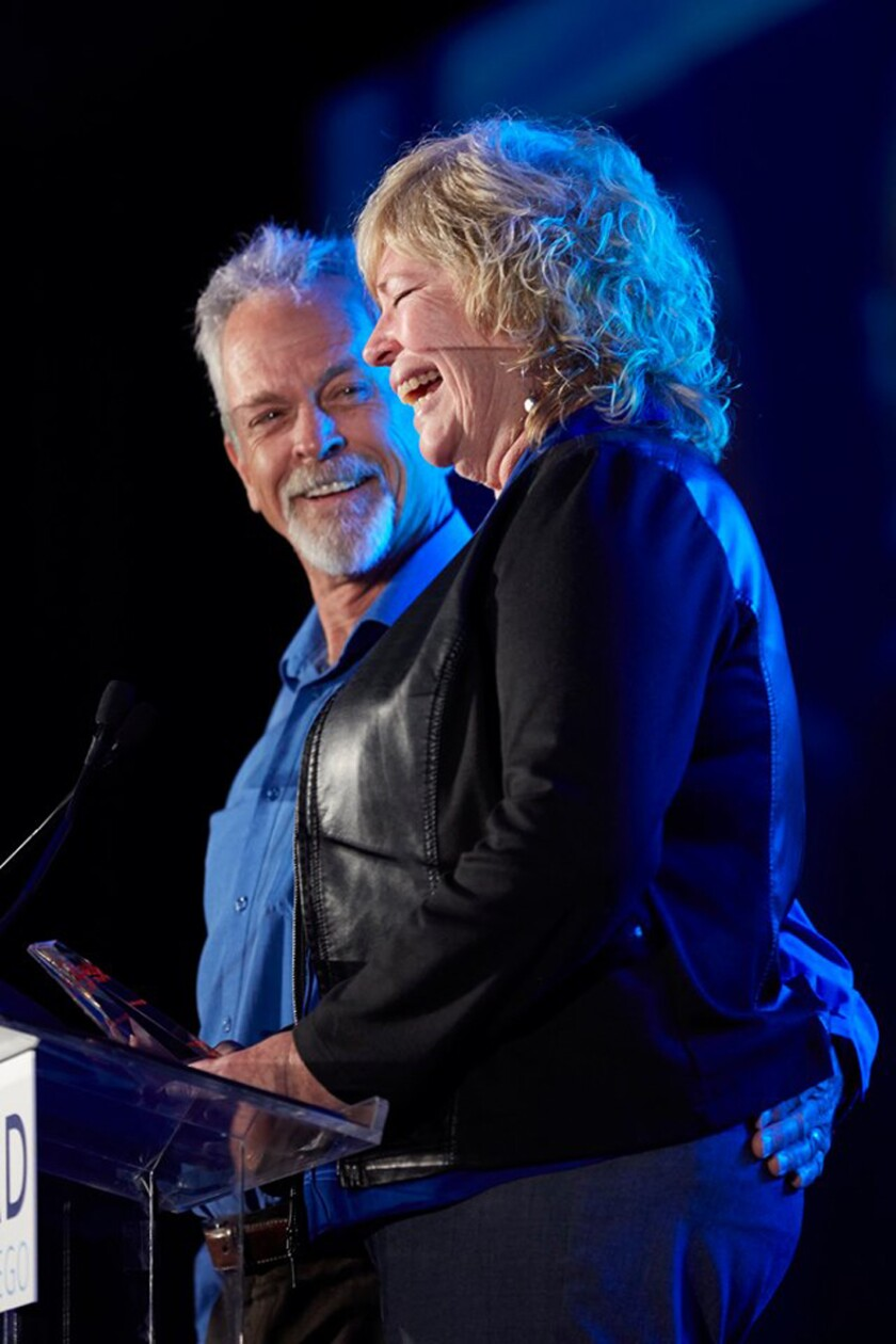 Steve and Mia Roseberry at the podium accepting LEAD San Diego's 2019 Visionary Award for Outstanding Community Service on June 6.