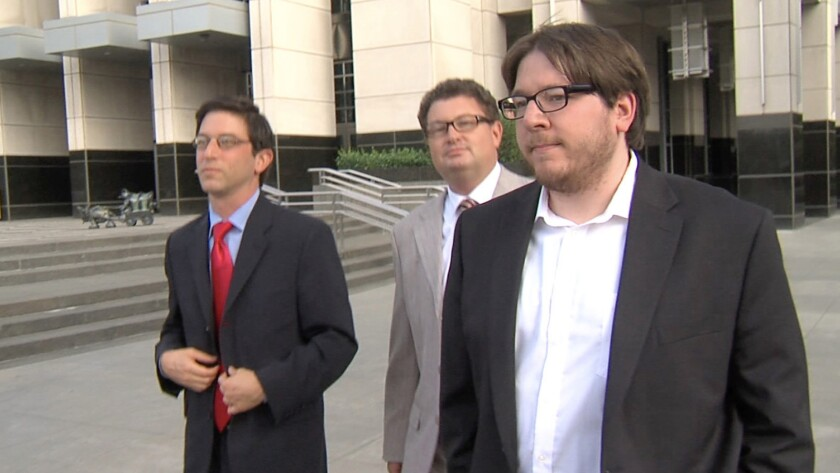 Matthew Keys leaves Federal Court in Sacramento with his attorneys after Wednesday's guilty verdict.