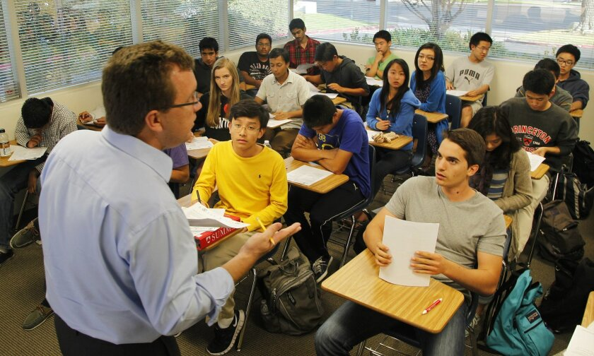 Christopher Hamilton, president and CEO of Summa Education, works with his SAT preparation class in Rancho Bernardo.