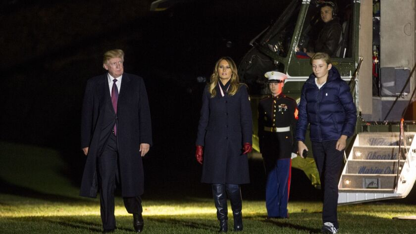 President Trump, Melania and Barron cross the South Lawn of the White House on Sunday after returning from Florida.