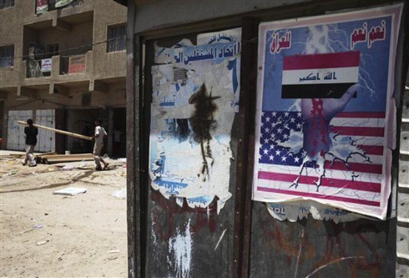 """An anti-American poster is seen in the Shiite stronghold of Sadr City  in Baghdad, Iraq, Saturday, April 30, 2009. Poster reads - """"Yes, Yes for Iraq"""". Respect for Islam, a prescription for Palestinian statehood, a promise to get out of Iraq quickly: That's what Muslims from Morocco to Malaysia want"""