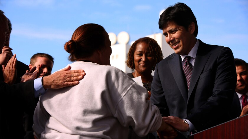State Senate President pro Tem Kevin de León (D-Los Angeles) invites a formerly homeless woman to speak at a press conference on Skid Row in downtown L.A. on Jan. 4.