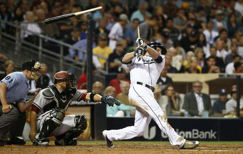 San Diego Padres' Cory Spangenberg splits his bat while hitting a slow roller that he beat out for a single in the fifth inning of a baseball game against the Arizona Diamondbacks on Friday, June 26, 2015, in San Diego. (AP Photo/Lenny Ignelzi)