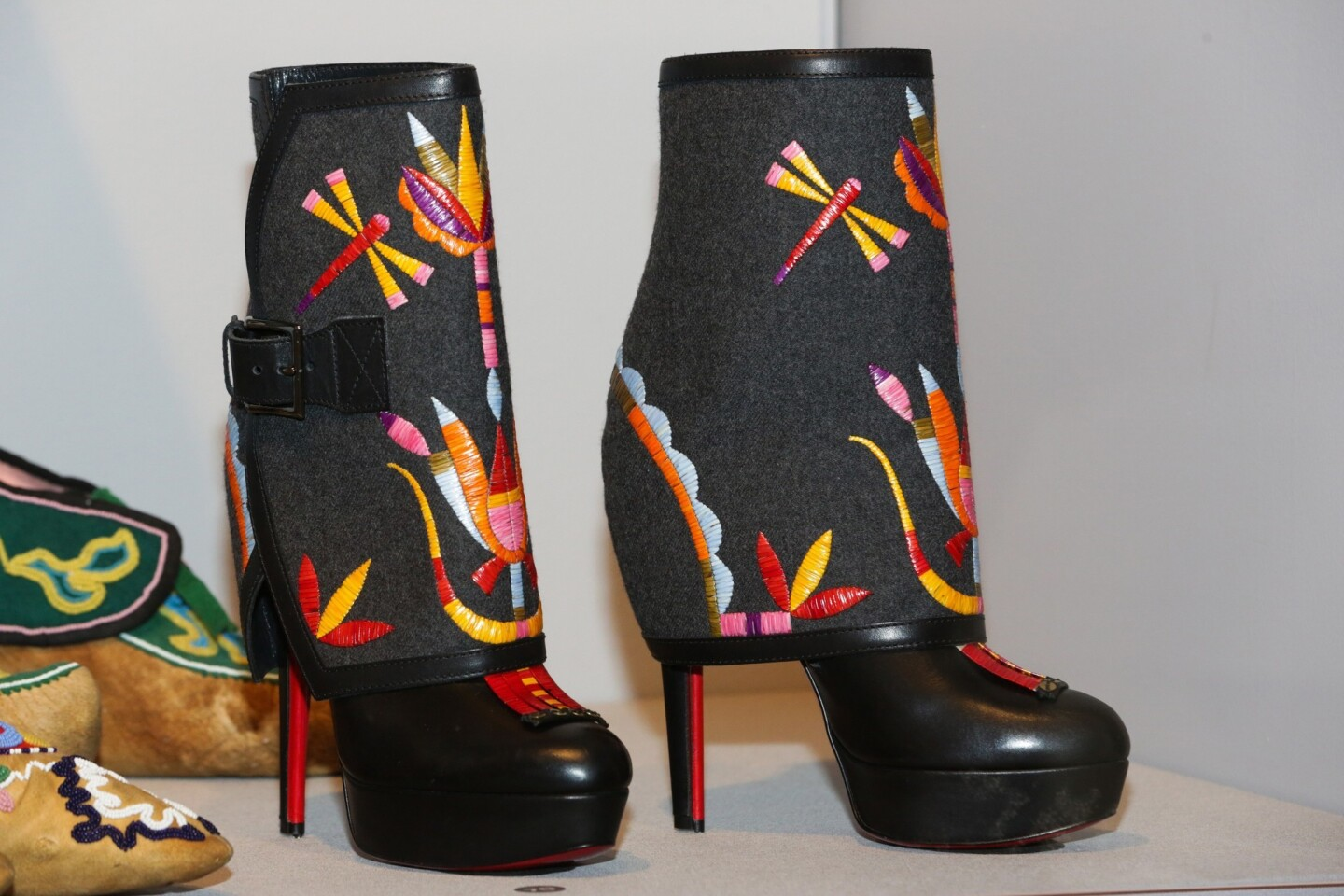 High-heeled boots by Jamie Okuma (Luise-o-Shoshone), 2012. Leather, wool felt, porcupine quills, thread, sequins, dyes, plastic. 10 inches.
