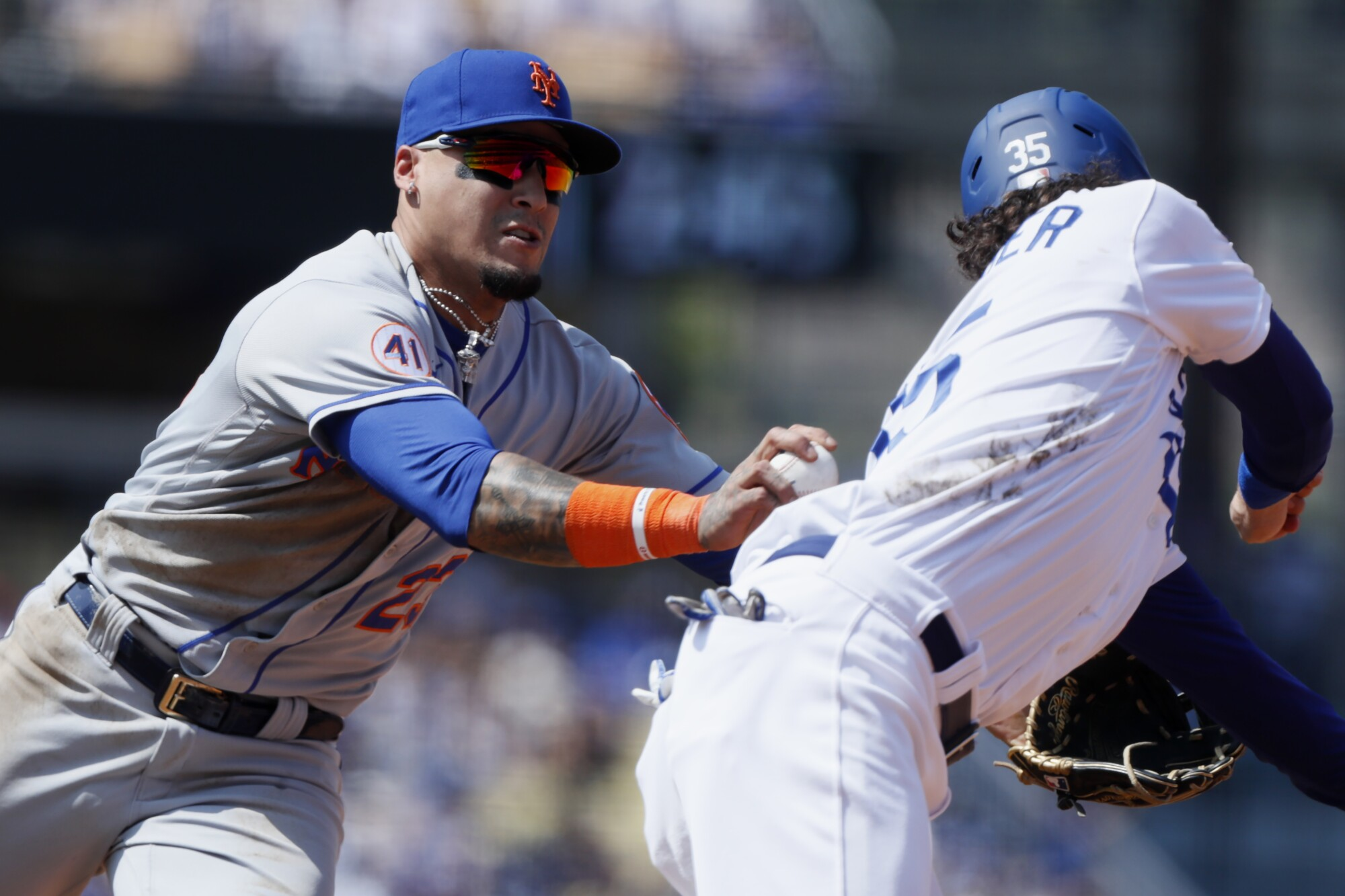 Mets shortstop Javier Baez tags out Cody Bellinger on a steal attempt during the fourth inning.
