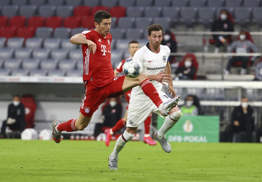 Eintracht Frankfurt's Timothy Chandler, right, in action with Bayern Munich's Benjamin Pavard during the German soccer cup semi-final match between Bayern Munich and Eintracht Frankfurt in Munich, Germany, Wednesday, June 10, 2020. (Kai Pfaffenbach/Pool via AP)