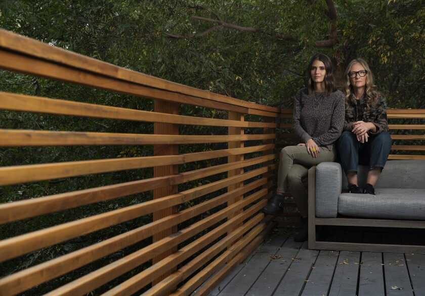"""Bikram: Yogi, Guru, Predator"" director Eva Orner, right, and Sarah Baughn, an alleged sexual assault victim of yoga instructor Bikram, are photographed at Orner's home in Nichols Canyon."